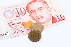 Singapore una banconota e le monete di dieci dollari Immagini Stock
