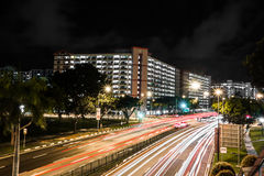 Singapore urban streets traffic. Singapore urban street night traffic busy movements Stock Photos