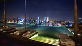 Singapore view. Singapore from swimming pool area on a skyscraper rooftop Royalty Free Stock Image