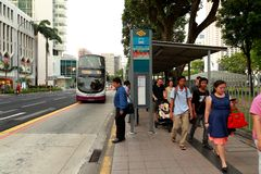 Singapore: Waiting for bus Royalty Free Stock Photography