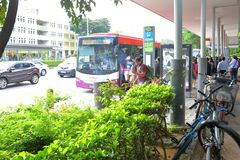 Singapore: Waiting for bus. Passenger waiting for bus at a busstop in the city Singapore Royalty Free Stock Photography
