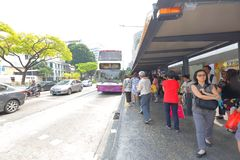 Singapore: Waiting for bus. Passenger waiting for bus at a busstop in the city Singapore Royalty Free Stock Photo