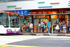 Singapore: Waiting for bus. Passenger waiting for bus at a busstop in the city Singapore Stock Photography