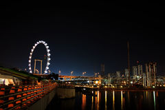 Singapore Waterfront. Night shot of the waterfront of the Singapore river, including ferris wheel royalty free stock photos