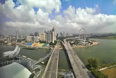Singapore waterfront and highways. Bayfront Ave. and Sheares Ave. Singapore waterfront promenade with highways, ferris wheel and city skyline stock photos