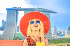 Singapore woman aperitif. Happy tourist enjoying in travel holiday, Singapore, Southeast Asia. Lifestyle caucasian woman with wide hat drinking aperitif at royalty free stock photos