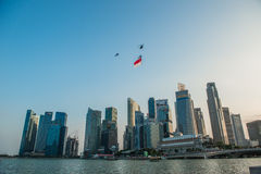Singapore 50 years National Day rehearsal helicopter hanging Singapore flag flying over the city royalty free stock photos