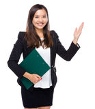 Singaporean businesswoman with clipboard and raiseing hand Stock Photos