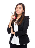 Singaporean businesswoman think of solution Stock Image