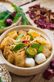 Singaporean Curry Noodle. Hot and spicy Singaporean Curry Noodle or laksa mee in clay pot, decoration setup, serve with chopsticks. Singapore cuisine Royalty Free Stock Photos
