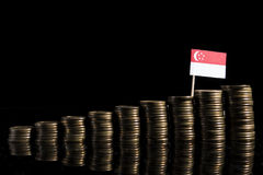 Singaporean flag with lot of coins  on black Royalty Free Stock Image