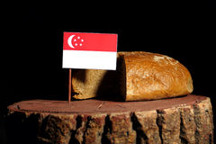 Singaporean flag on a stump with bread royalty free stock photo