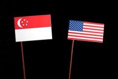 Singaporean flag with USA flag  on black. Background Stock Photo
