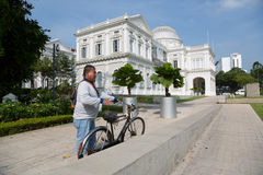 Singaporean in front of the National Museum of Singapore Stock Images