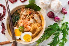 Singaporean prawn mee. Singaporean prawn noodles or har mee. Famous Singapore food spicy fresh cooked prawn mee in clay pot with hot steam. Asian cuisine stock image