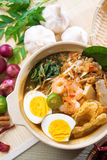 Singaporean prawn noodles. Or prawn mee. Famous Singapore food spicy fresh cooked har mee in clay pot with hot steam. Asian cuisine stock image