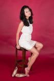 Singaporean woman. Slender young Singaporean Chinese woman in a white dress Royalty Free Stock Photo