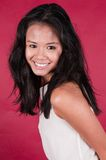 Singaporean woman. Slender young Singaporean Chinese woman in a white dress Stock Images