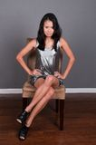 Singaporean woman. Slender young Singaporean Chinese woman in a silver dress Stock Photography