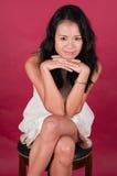 Singaporean woman. Slender young Singaporean Chinese woman in a white dress Stock Photos