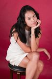 Singaporean woman. Slender young Singaporean Chinese woman in a white dress Royalty Free Stock Images