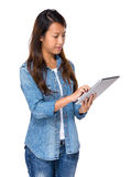 Singaporean woman use digital tablet Stock Photo