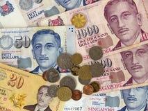 Singapur-Bargeld-Banknoten u. Münzen Stockfoto