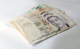 Singapur-Dollar auf weißem Hintergrund Stockbild