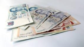 Singapur-Dollar auf weißem Hintergrund Stockfotos