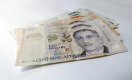 Singapur-Dollar auf weißem Hintergrund Lizenzfreie Stockbilder