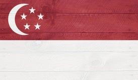Singapur - Flagge auf hölzernen Brettern mit Nägeln Lizenzfreie Stockfotos
