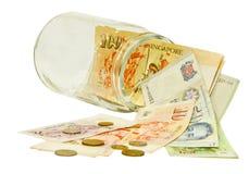 Singapur-Geld in einem Glas Lizenzfreie Stockfotografie