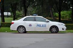 Singapur-Polizei-Streifenwagen geparkt Lizenzfreies Stockbild