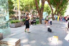 Singapur: Uliczny wykonawca Zdjęcie Royalty Free