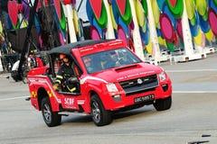 Singapur-Zivilverteidigungs-Kraft (SCDF) sein helles Löschangrifffahrzeug während Wiederholung 2013 zeigend der Nationaltag-Parade Lizenzfreies Stockbild