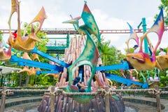 SINGAPURA - 20 DE JULHO: Tema de Jurassic Park no si dos estúdios universais fotografia de stock royalty free