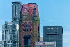 Singapura - 10 de junho de 2018: Skyline do centro dos hotéis Fotografia de Stock Royalty Free