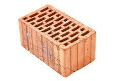 Singe Brick Closeup. Old dirty brick on white background Stock Photos