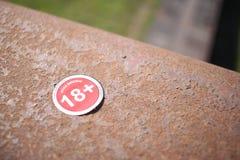 18+. Singe on metal handrail Stock Images