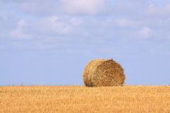 Singel bale of straw. Single bale of straw against a bright blue sky Stock Photo