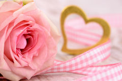 Singel rose as present with golden heart Royalty Free Stock Images