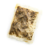 Singel used wet tea bag. On a white background Stock Photography