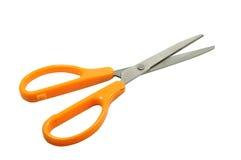 Singeln scissor med det orange handtaget stationärt Royaltyfri Fotografi
