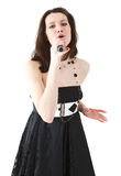 Singer. Young lady singing in microphon isolated on white background Royalty Free Stock Photo
