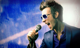 Singer. Portrait of male singer with microphone Stock Image