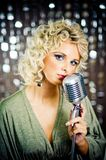 Singer. Beautiful young singer with retro microphone Stock Image