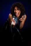Singer. African american singer holding microphone Stock Photography