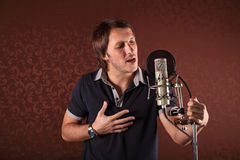 Singer. Pop singer singing a song in the recording Studio Stock Photography