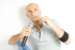 Singer. With microphone on a withe background Stock Photos