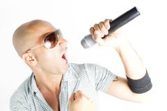 Singer. With microphone on a withe background Stock Photography